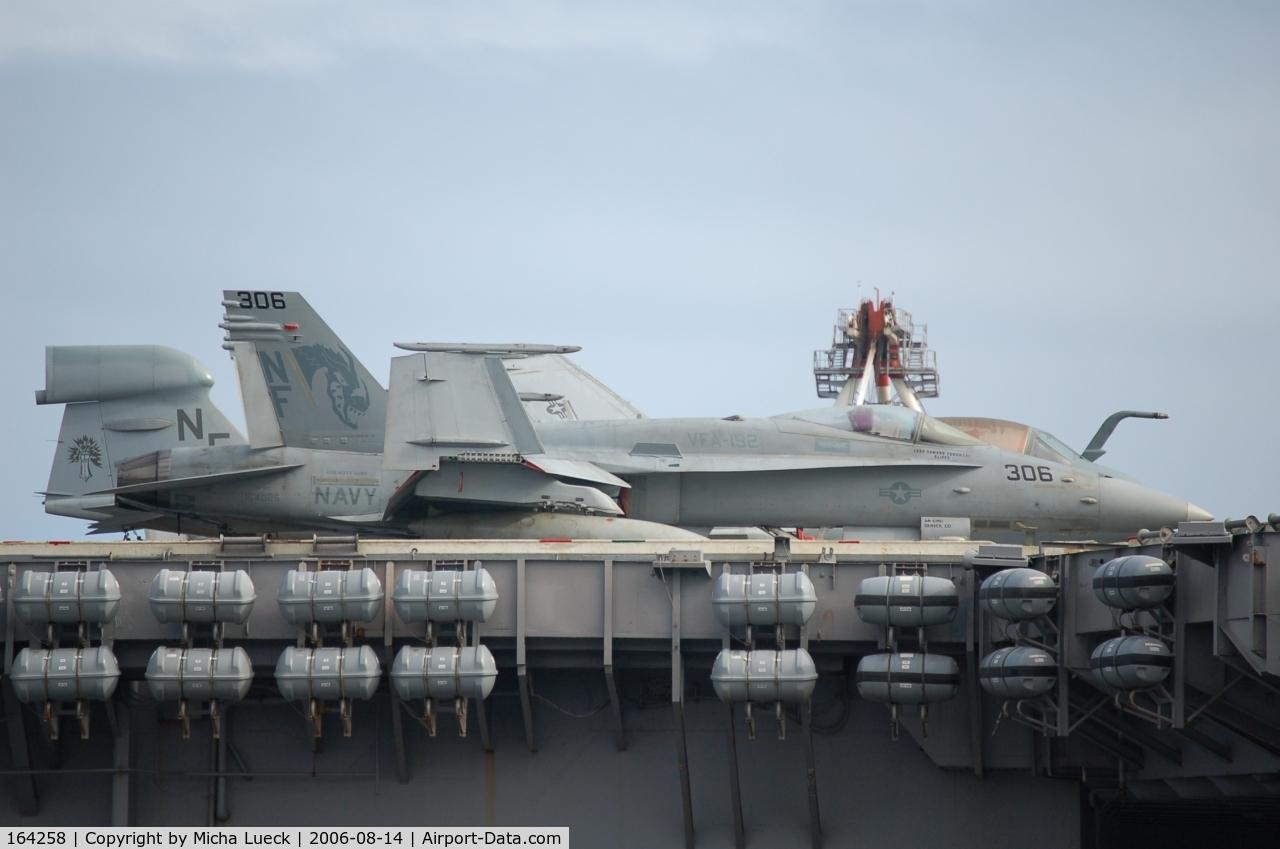 164258, 1991 McDonnell Douglas F/A-18C Hornet C/N 1021/C239, McDonnell Douglas F/A 18C Hornet (c/n 164258) and Grumman EA-6B Prowler (G-128) on the Kitty Hawk in Fremantle, Australia