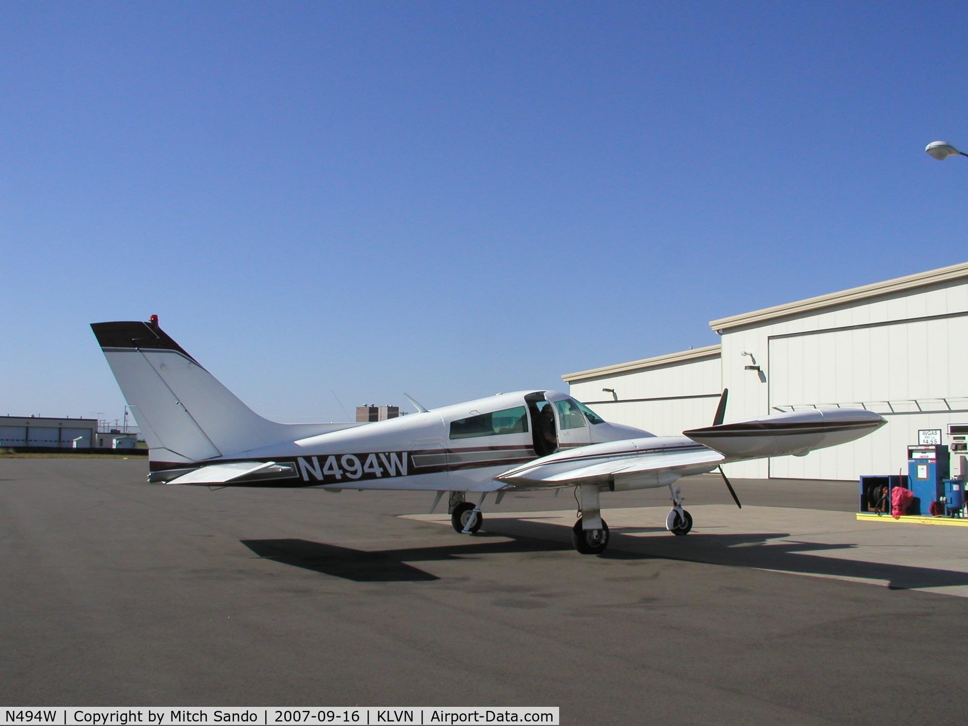 N494W, 1966 Cessna 310K C/N 310K0103, Parked at the fuel pumps at Airlake.