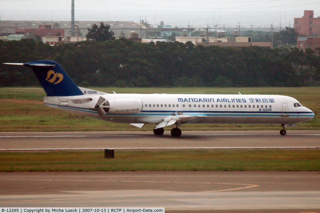 B-12295, 1994 Fokker 100 (F-28-0100) C/N 11527, Just touched down, thrust reversers deployed