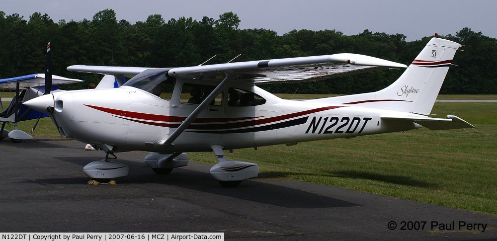 N122DT, 2000 Cessna 182S Skylane C/N 18280908, This young lady really stands out against the forest