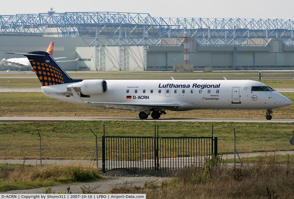 D-ACRN, 2001 Canadair CRJ-200LR (CL-600-2B19) C/N 7486, Taxiing rwy 14L for departure
