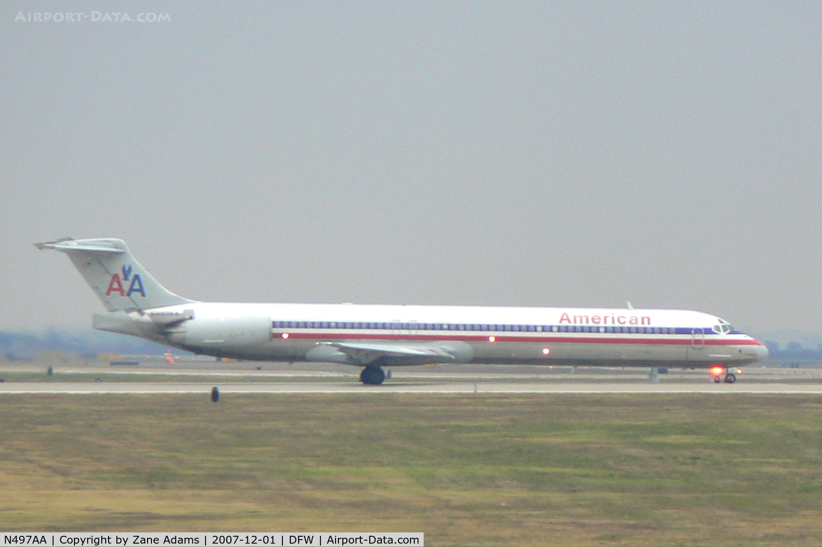 N497AA, 1989 Mcdonnell Douglas DC-9-82(MD-82) C/N 49735, Rainy day at DFW - Holding short 18L