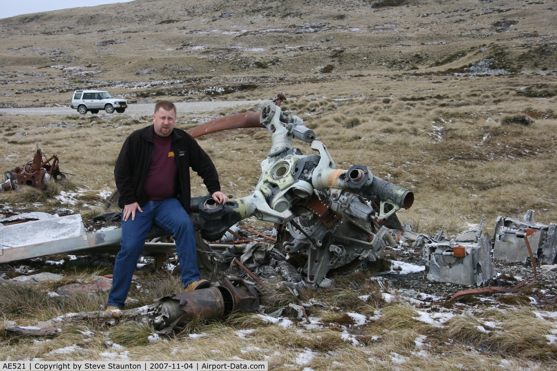 AE521, Boeing Vertol CH-47C Chinook C/N B-789/CG-102, This is me sitting on the wreck of BV Chinook CH-47C of the Argentine AF located at the foot of Mount Kent, Falkland Island. This aircraft was destroyed during the 1982 Falklands Conflict. Notice the snow on the ground - yes a cold Spring November day