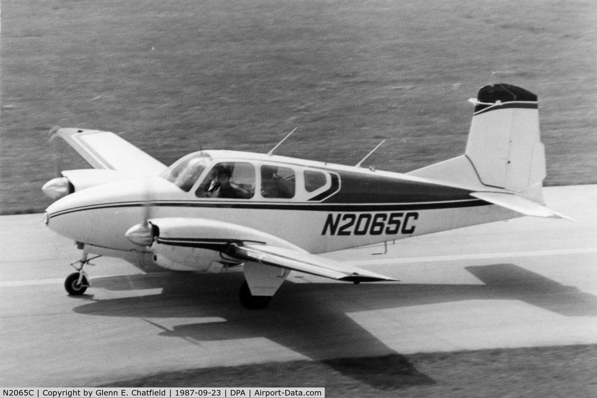 N2065C, 1959 Beech B95 C/N TD-208, Photo taken for aircraft recognition training.  Taxiing by the control tower.