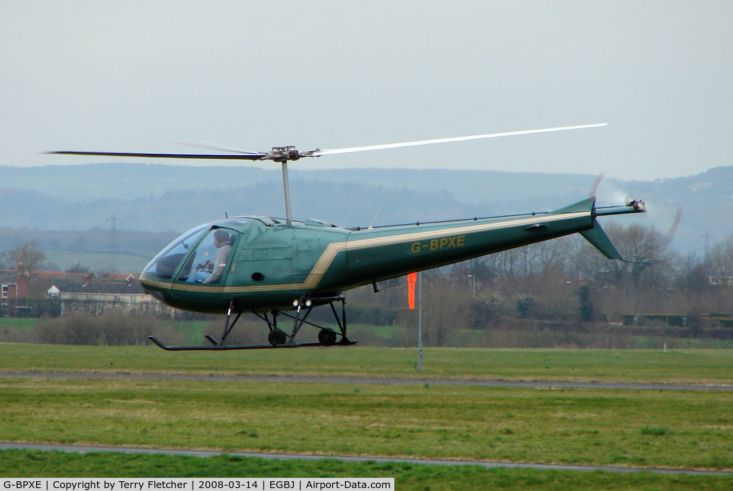 G-BPXE, 1977 Enstrom 280C Shark C/N 1089, A visitor to Gloucestershire Airport on the day of the horse racing Gold Cup  at the nearby Cheltenham Racecourse