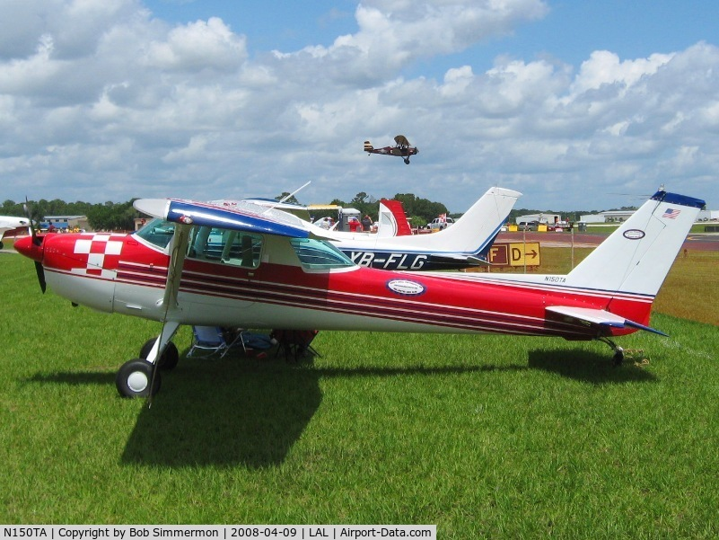 N150TA, 1976 Cessna A150L Aerobat C/N A1500683, Sun N Fun 2008.  New Standard flying by in the background.