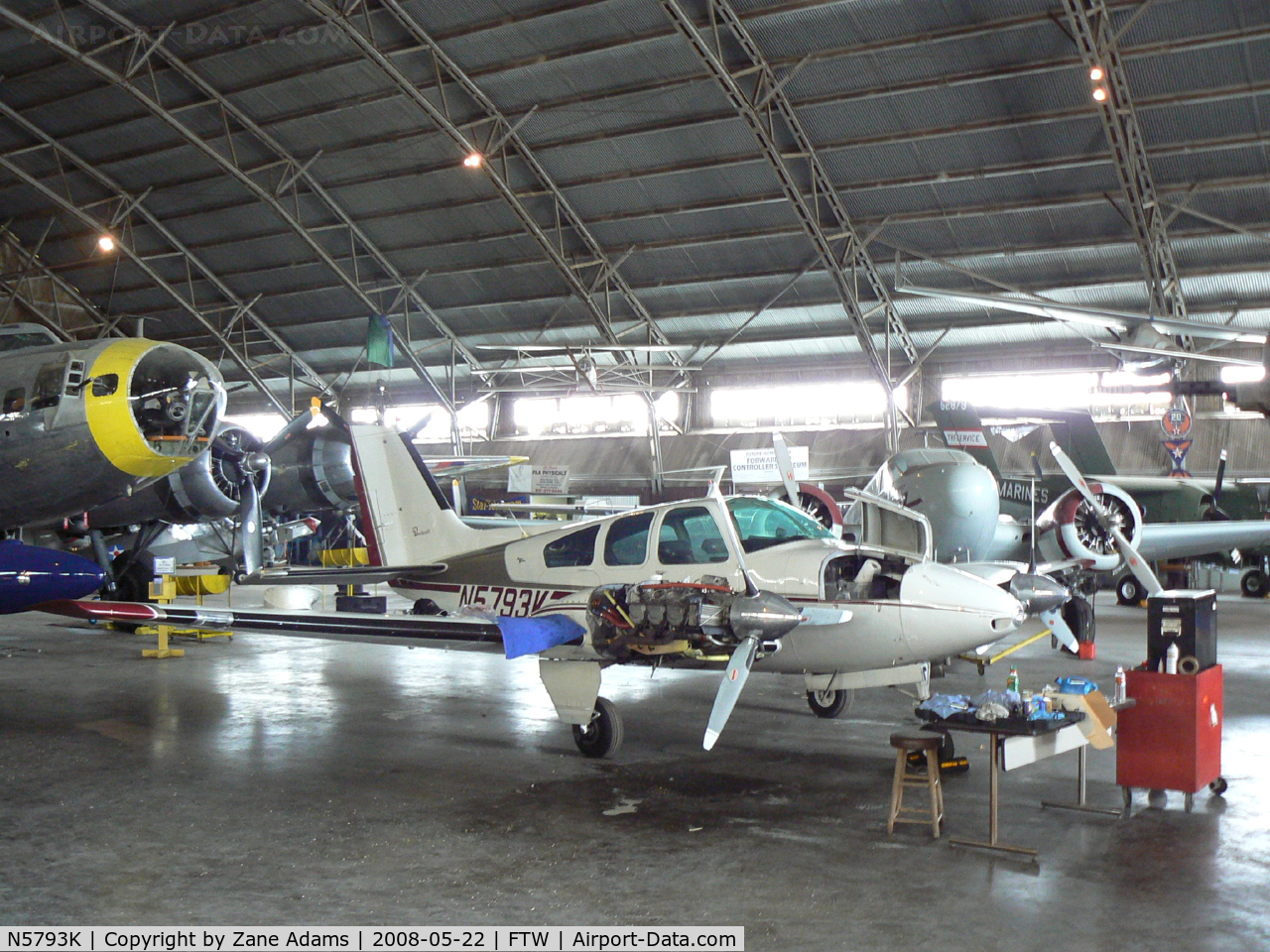 N5793K, 1964 Beech 95-B55 (T42A) C/N TC-749, At Meacham Field - in the Vintage Flying Museum hanger