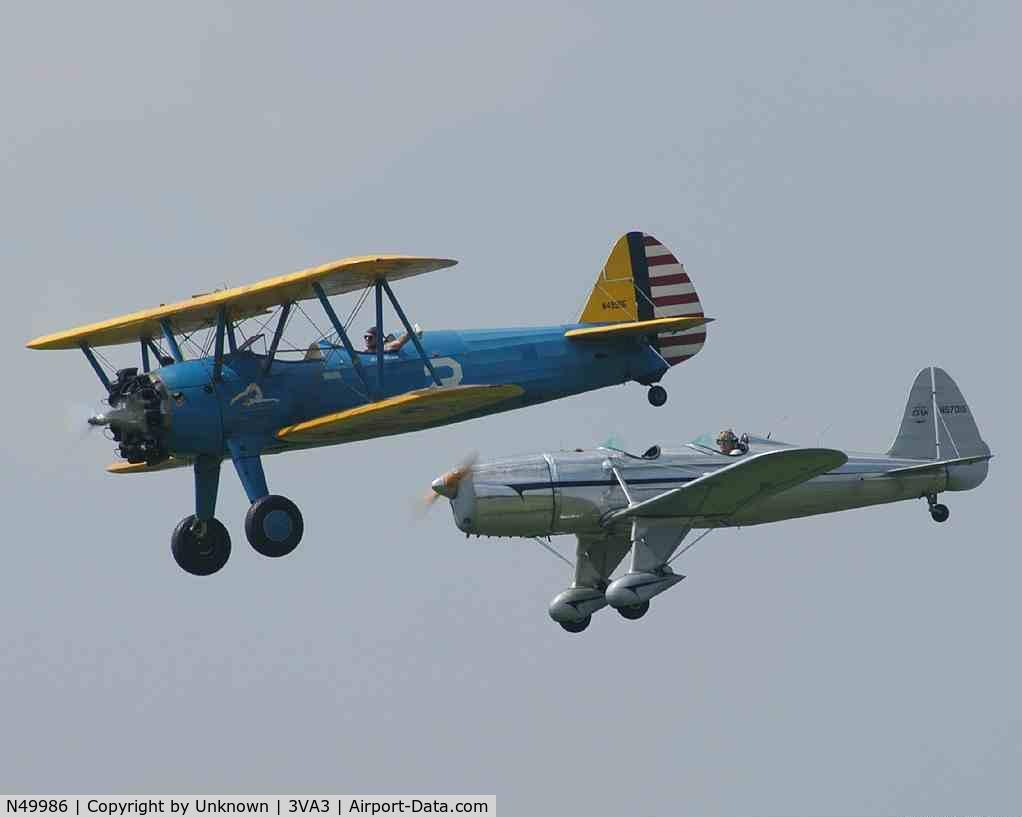 N49986, 1942 Boeing A75N1(PT17) C/N 75-1726, In formation with a Ryan PT-22