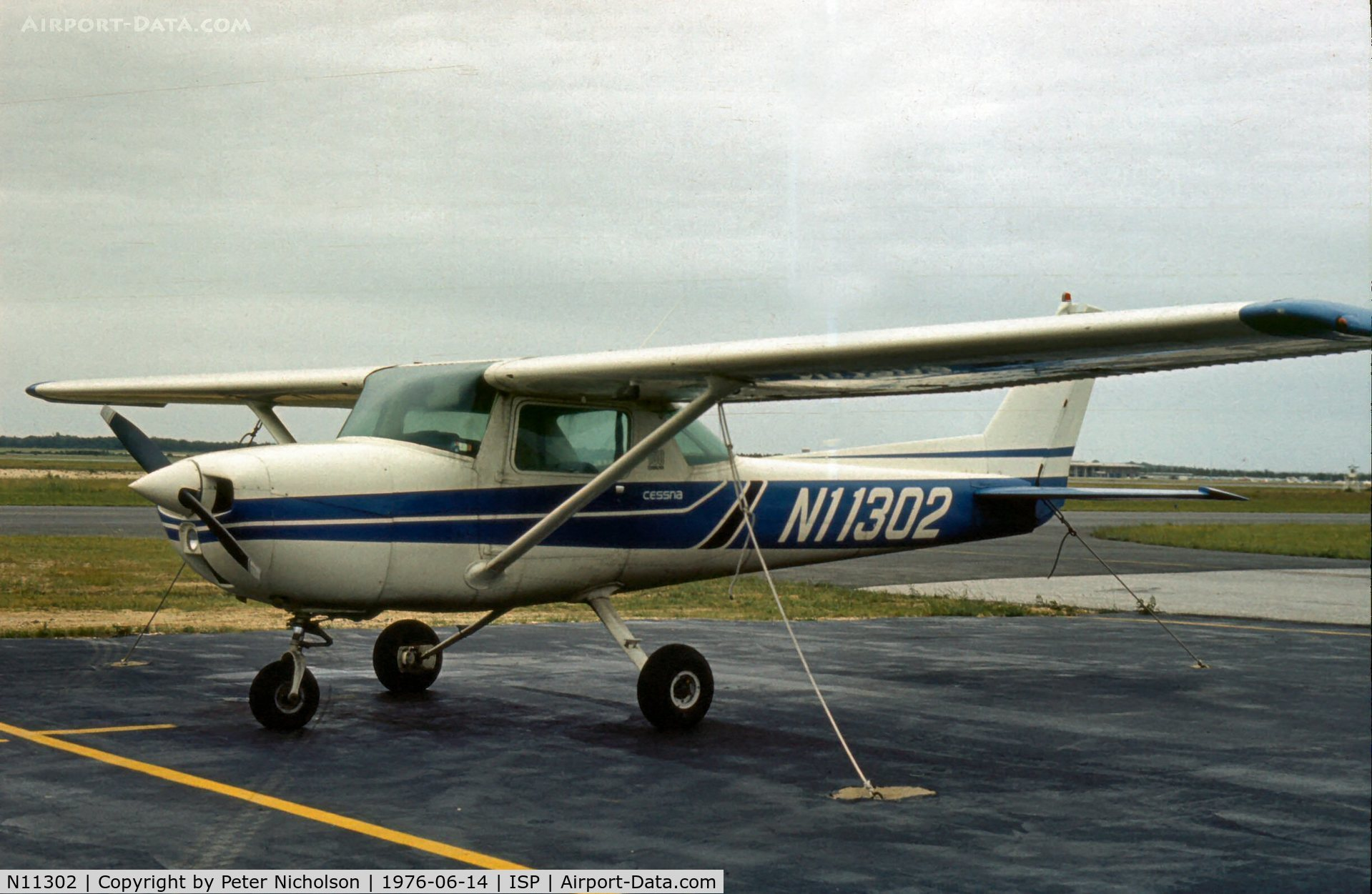 N11302, 1973 Cessna 150L C/N 15075311, This Cessna Commuter was parked at Islip-MacArthur in the summer of 1976.