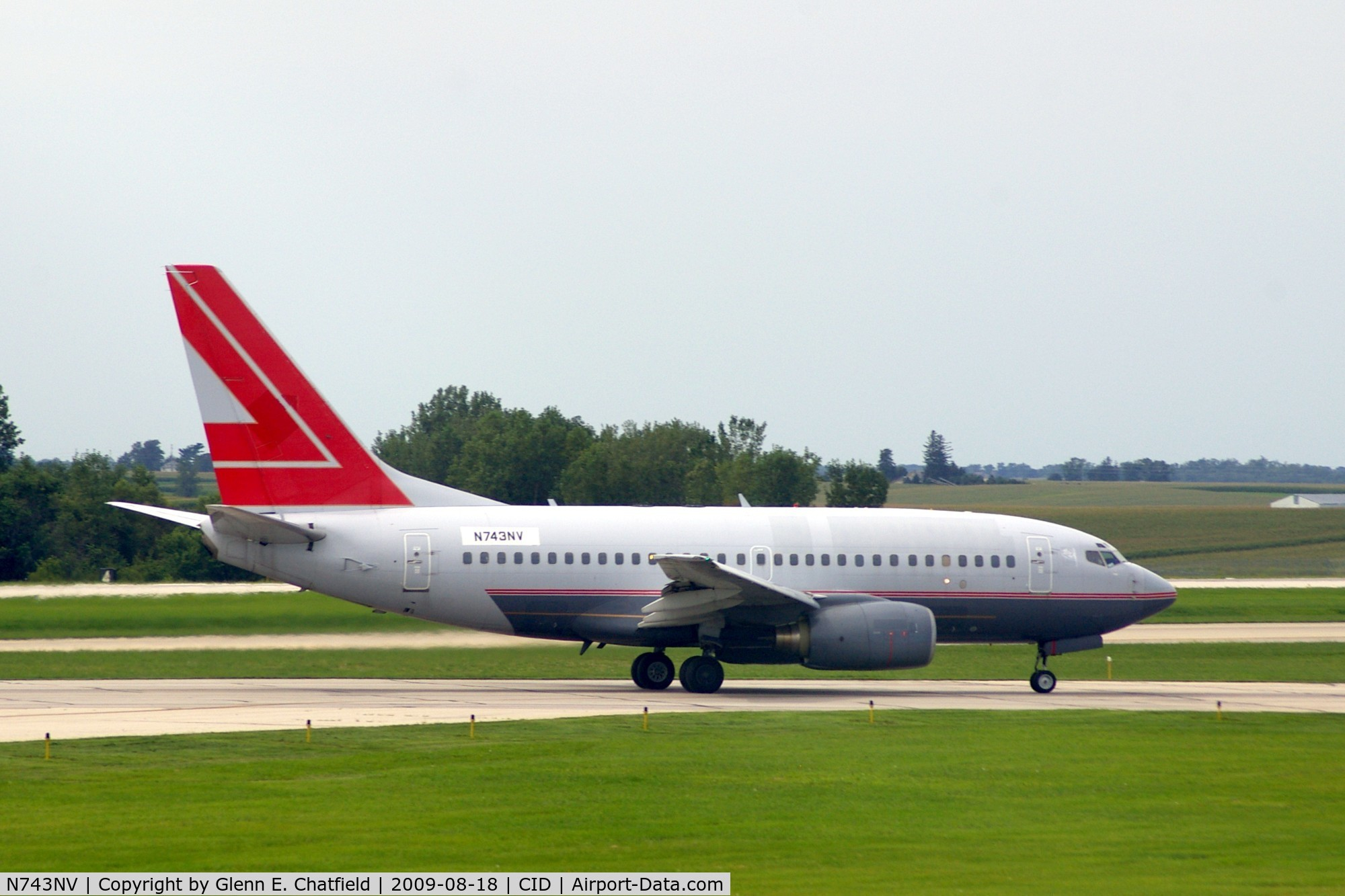 N743NV, 2000 Boeing 737-6Z9 C/N 30137, Doing touch and goes on Ry 31.  Seen from my window.