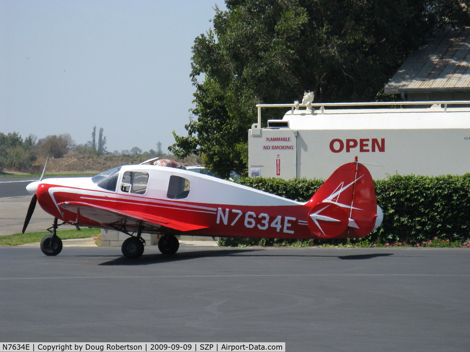 N7634E, 1959 Downer Bellanca 14-19-3 C/N 4136, 1959 Downer Bellanca 260 14-19-3 Cruisemaster, Continental O-470-F 260 Hp, refueling, last of the triple-tail Bellancas model-the 260A went to single tail.