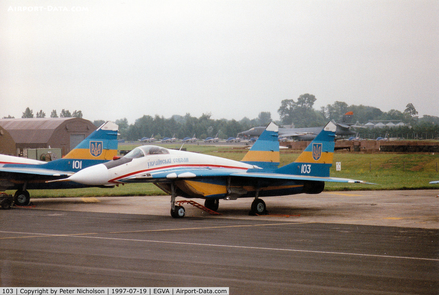 103, Mikoyan-Gurevich MiG-29A C/N 31227, MiG-29A Fulcrum of the Ukranian Falcons display team on the flight-line at the 1997 Intnl Air Tattoo at RAF Fairford.