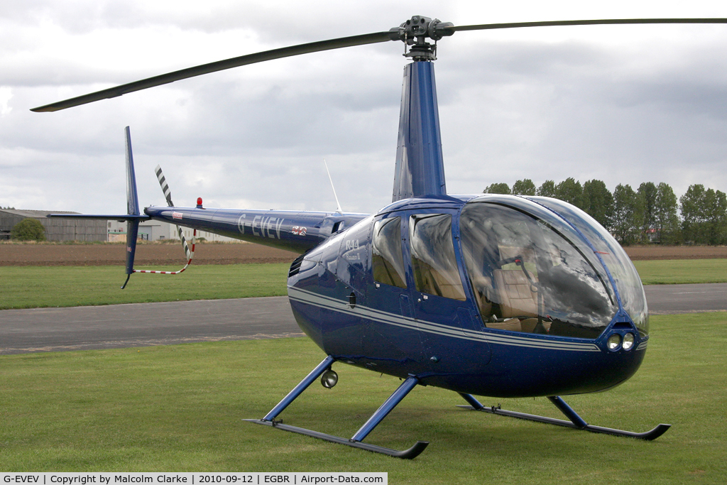 G-EVEV, 2005 Robinson R44 Raven ll C/N 10908, Robinson R44 Raven ll at Breighton Airfield during the September 2010 Helicopter Fly-In.