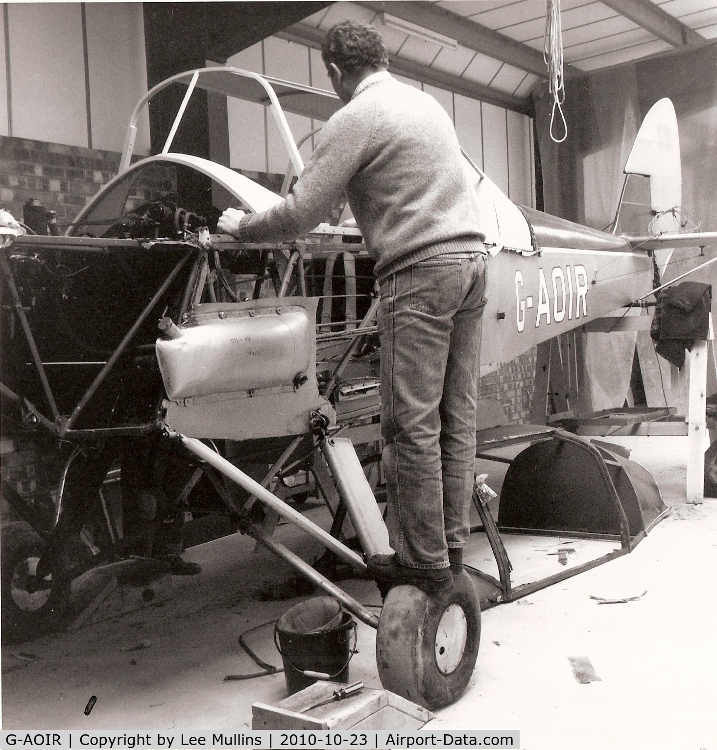 G-AOIR, 1943 Thruxton Jackaroo C/N 82882, G-AOIR at Meppershall, when operated by The Stevenage Flying Group. A steel framed cabin had just been fitted to replace the rapidly deteriorating wooden original. Les Smith, who later purchased the aircraft, is working on the fuselage.