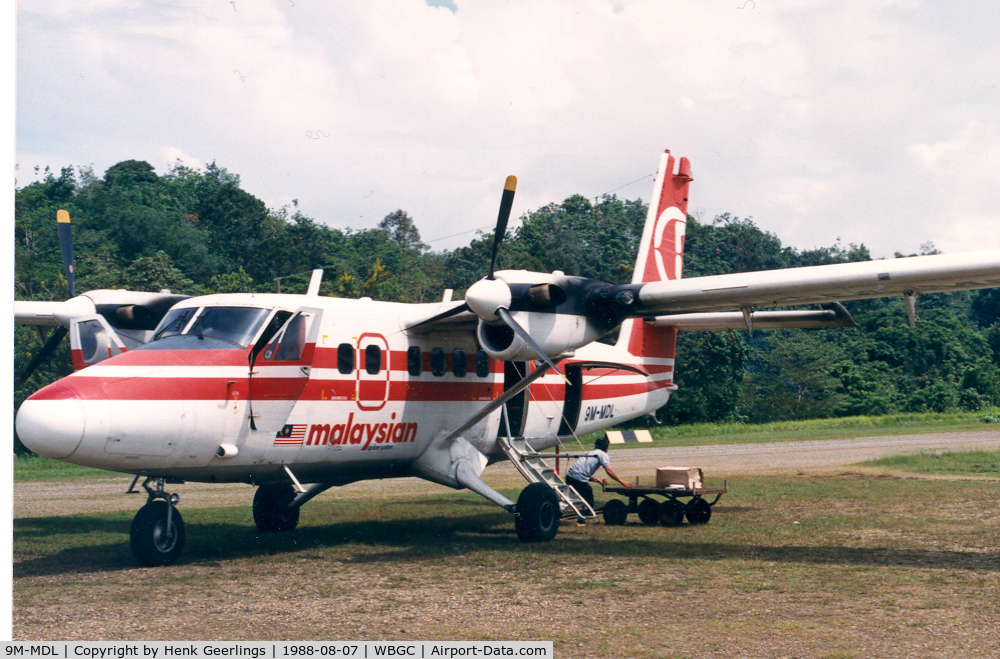 9M-MDL, De Havilland Canada DHC-6-300 Twin Otter C/N 802, Malaysian , Twin Otter at Belaga landing strip , 1988