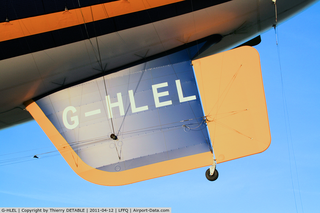 G-HLEL, 1995 American Blimp Corp A-60+ C/N 10, Tail and the Small wheel (certainly Goodyear) The tail is hung with ropes and patches on the envelope