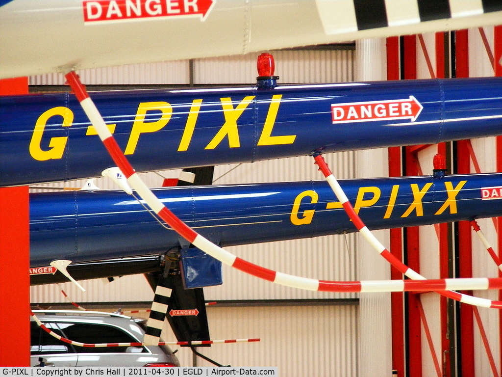 G-PIXL, 2006 Robinson R44 Raven II C/N 11221, along side G-PIXX