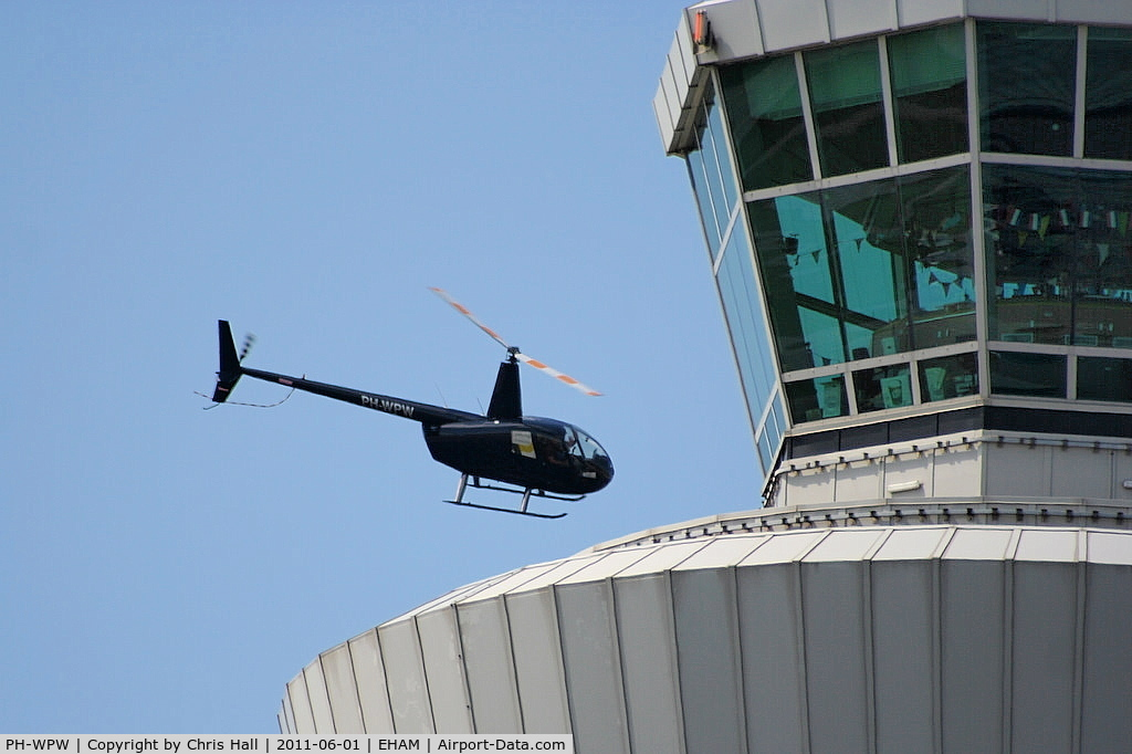 PH-WPW, Robinson R44 Raven I C/N 2078, buzzing the tower at Schiphol