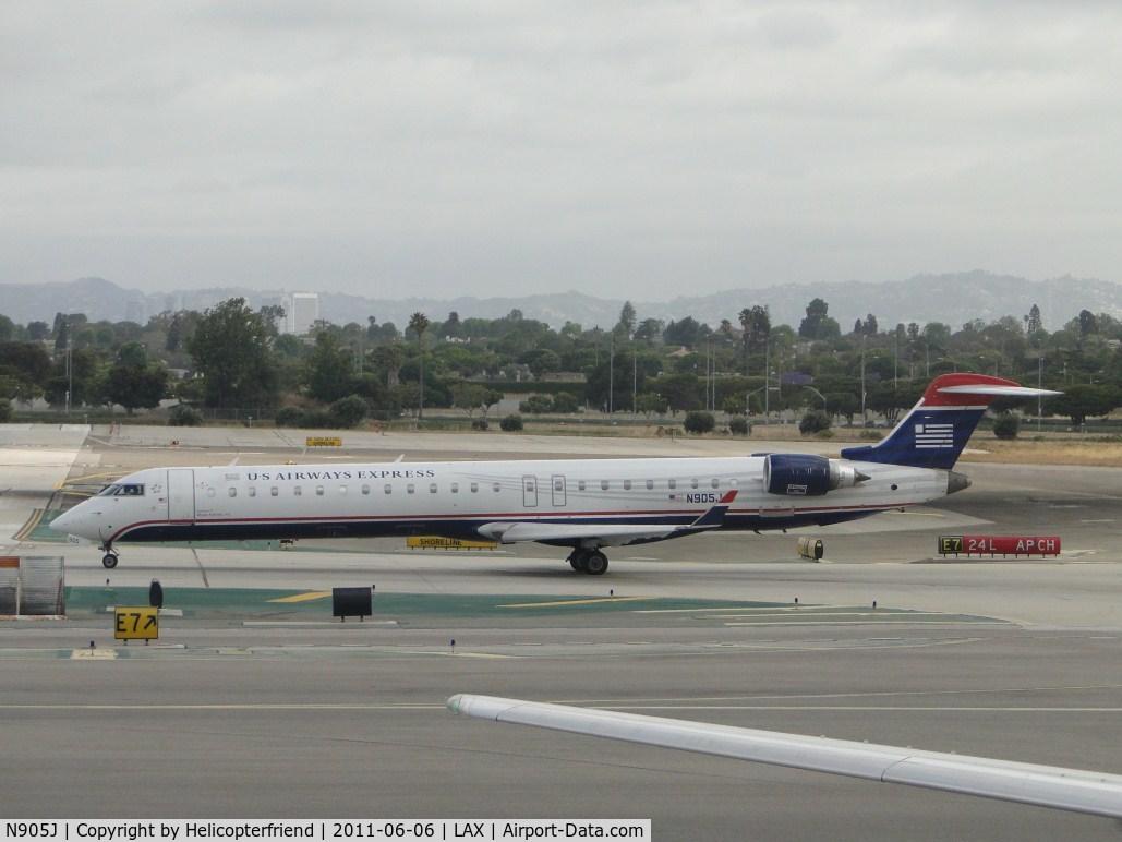 N905J, 2003 Bombardier CRJ-900 (CL-600-2D24) C/N 15005, Waiting to taxi onto runway 24L