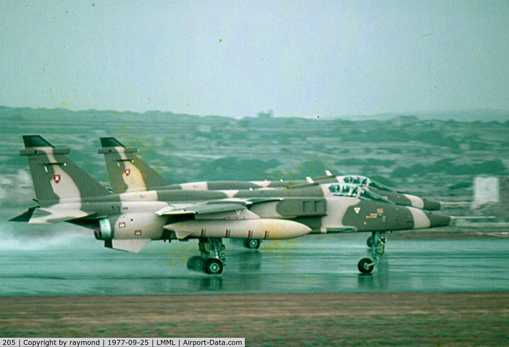 205, 1977 Sepecat Jaguar S C/N 210/S(O)3, Jaguars 205 and 206 of Oman Air Force being delivered through Malta in September 1977. Seen here on departure double take-off.