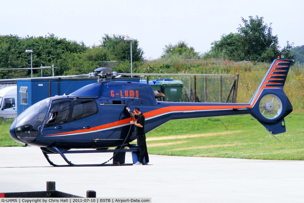 G-LHMS, 2006 Eurocopter EC-120B Colibri C/N 1442, being used for ferrying race fans to the British F1 Grand Prix at Silverstone