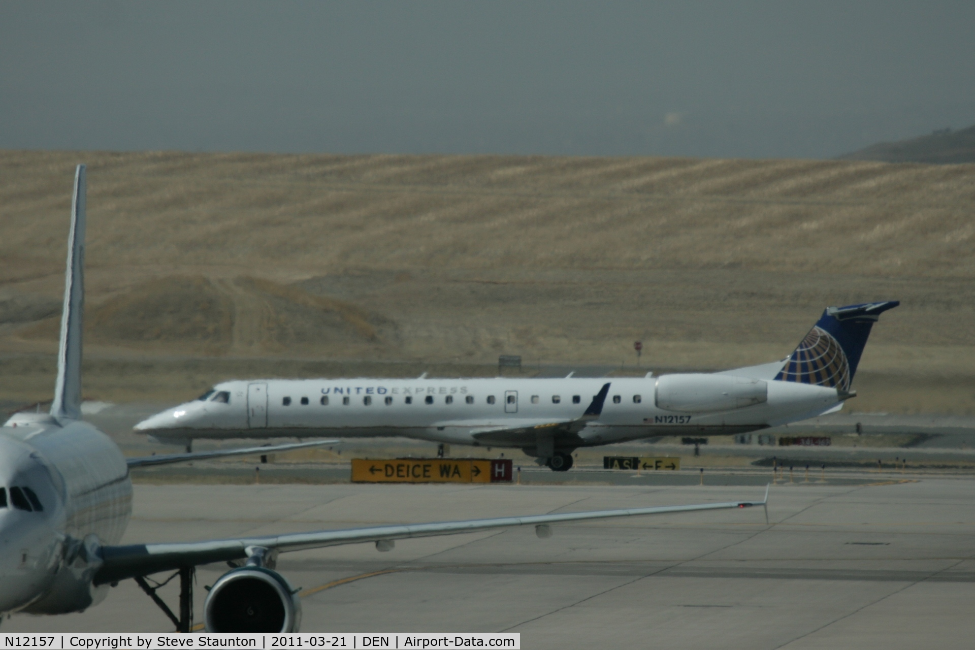N12157, 2004 Embraer EMB-145XR C/N 145787, Taken at Denver International Airport, in March 2011 whilst on an Aeroprint Aviation tour