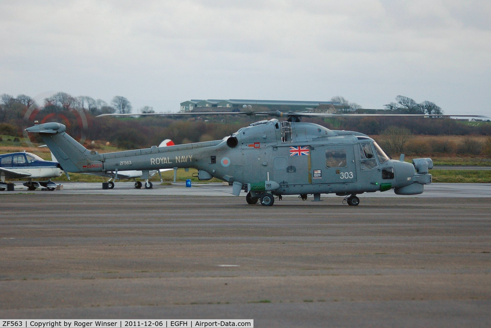 ZF563, 1988 Westland Lynx HMA.8SRU C/N 340, Coded 303 of 815 NAS. About to depart after taking on fuel.