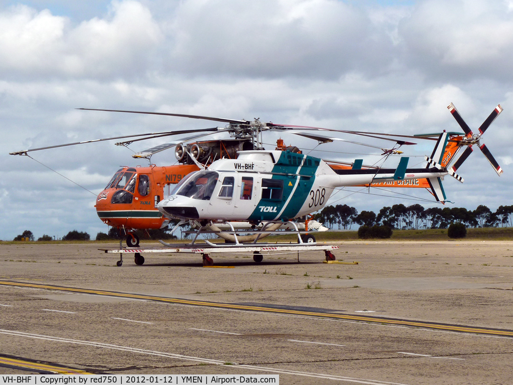 VH-BHF, 1979 Bell 206L-1 LongRanger II C/N 45164, VH-BHF on dolley in front of Sikorsky S64F N197AC, aerial firefighter
