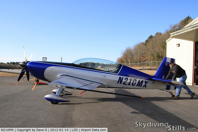 N210MX, 2005 Extra EA-300/L C/N 1210, Getting pushed out of a hangar at Danielson, CT