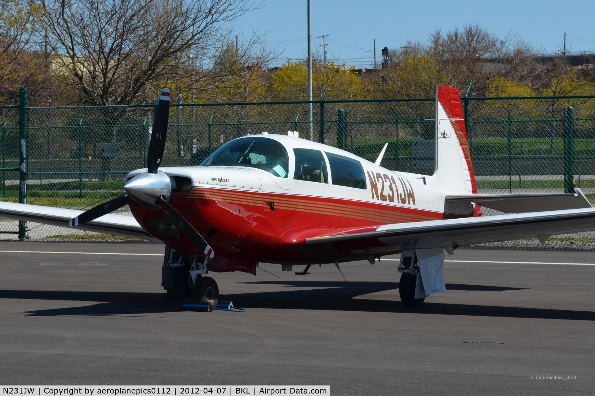 N231JW, 1979 Mooney M20K C/N 25-0031, N231JW seen at KBKL in red paint.