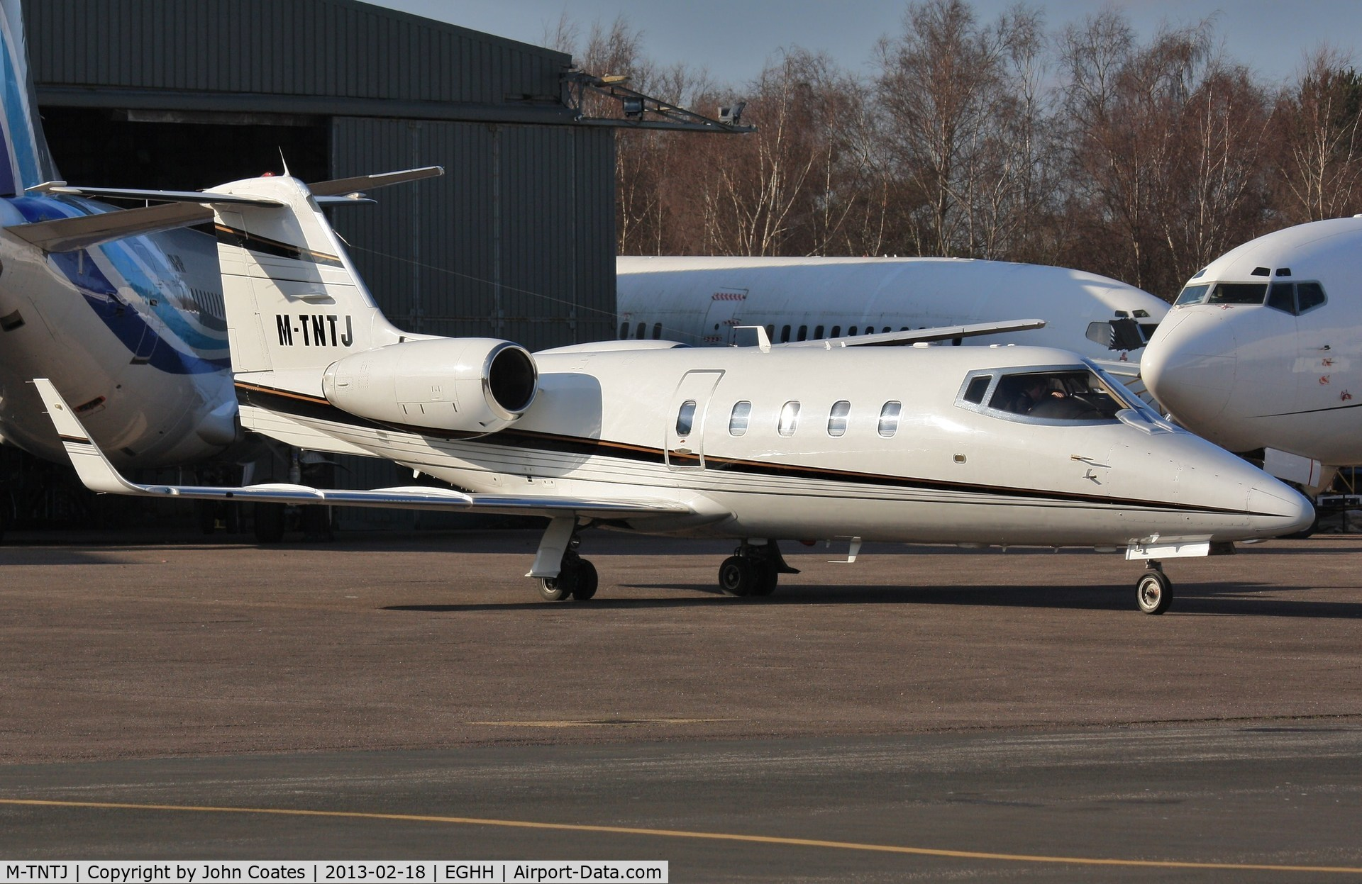 M-TNTJ, 1983 Learjet 55 C/N 55-087, Parling up on European ramp with crew for OO-TNQ