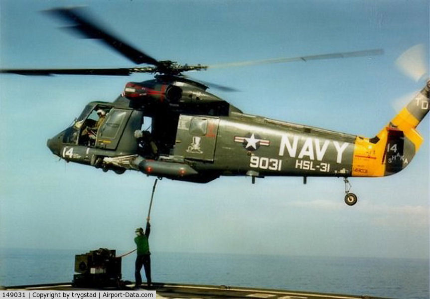 149031, Kaman HH-2D Seasprite C/N 035, Shaka 14 hooks up a cargo load from the deck of USNS Harkness (T-AGS 32)  in the Banda Sea, Indonesia, late 1986. Photo by AE2 Barry Sinclair.