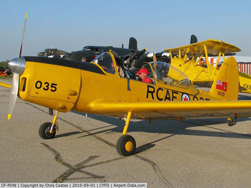 CF-POW, 1956 De Havilland Canada DHC-1B-2-S5 Chipmunk Mk2 C/N 173-211, After an airshow, this Chipmunk's pilots were getting ready to leave. This airport is 51 nm Southwest of downtown Toronto.