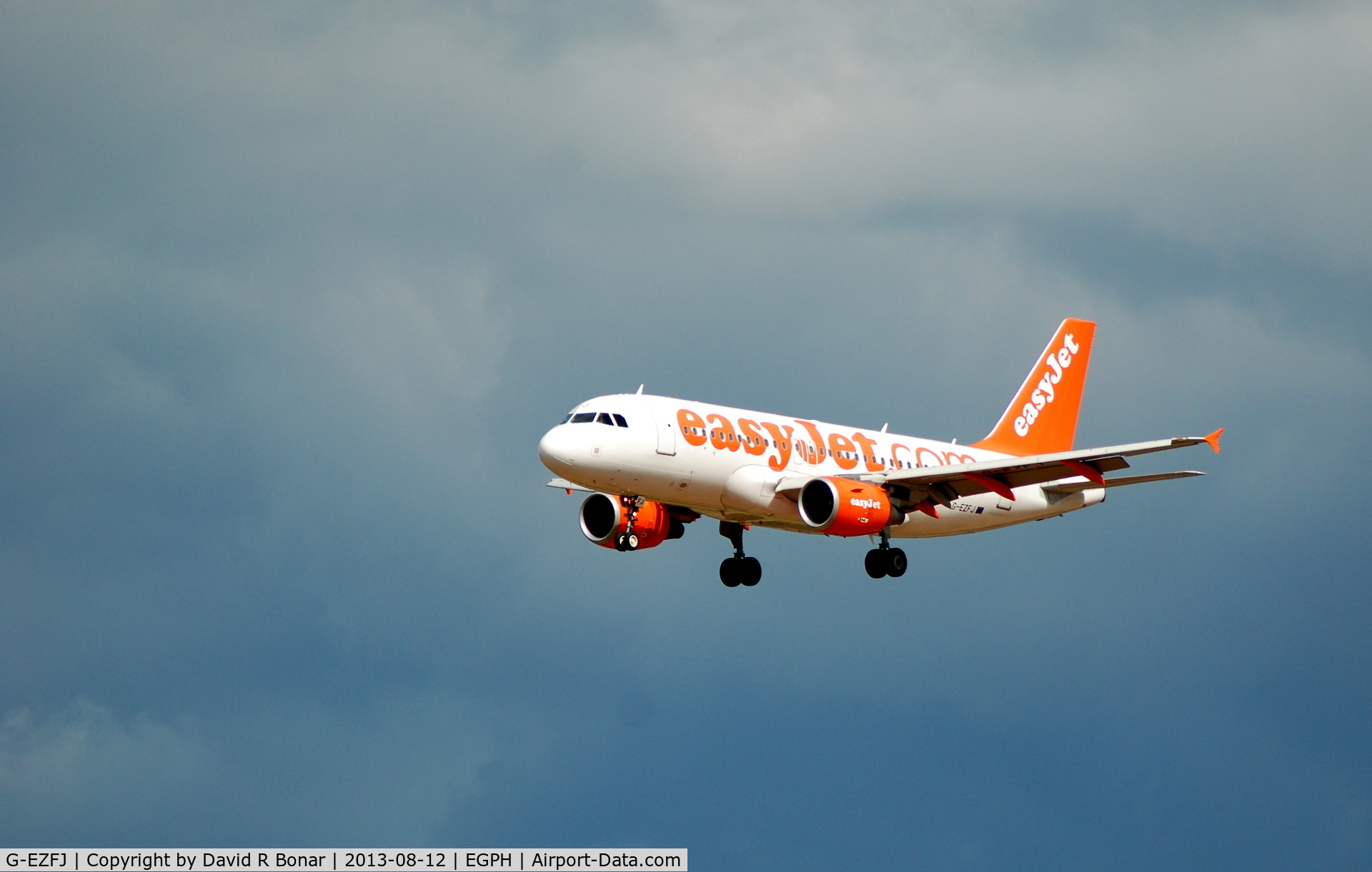 G-EZFJ, 2009 Airbus A319-111 C/N 4040, Short finals in-front of an agry sky