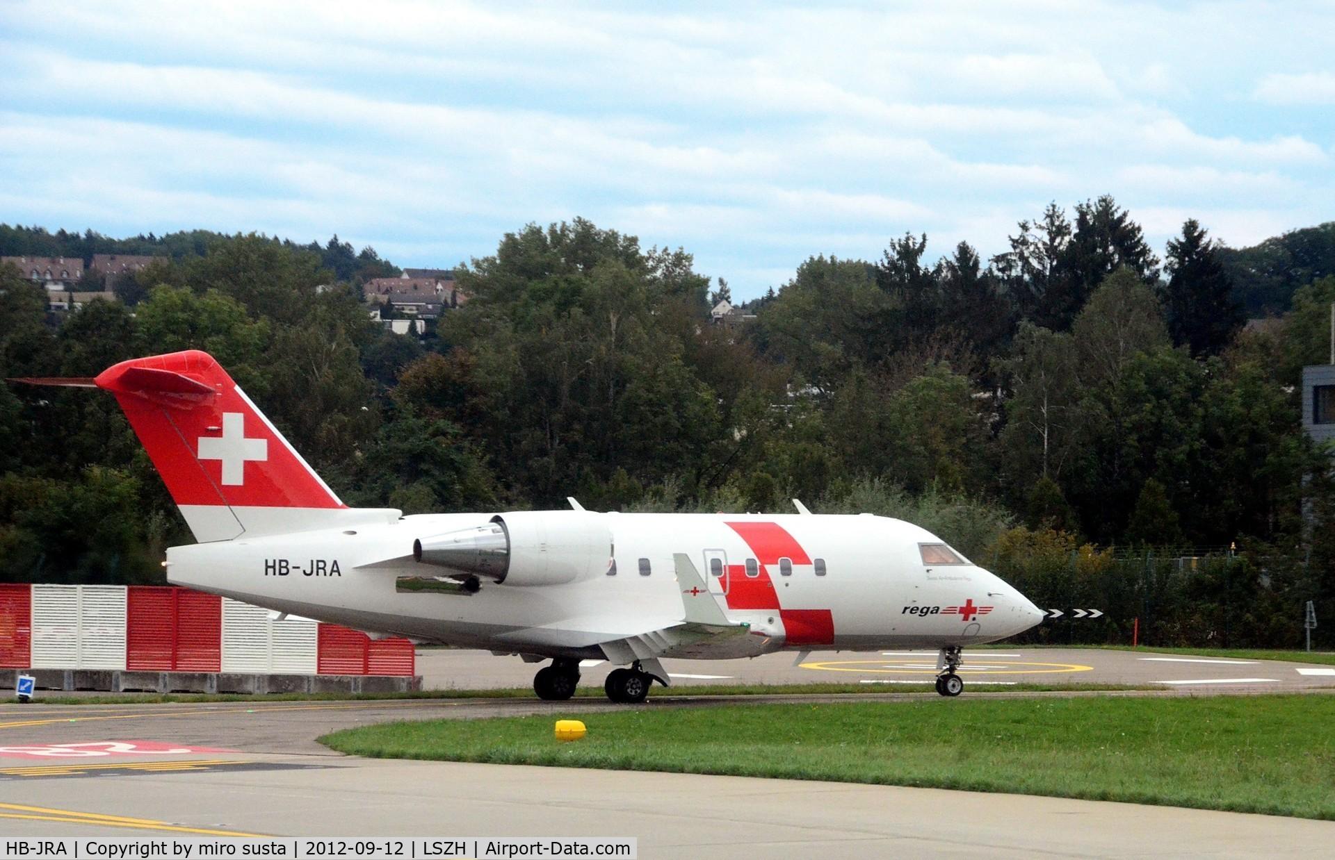 HB-JRA, 2002 Bombardier Challenger 604 (CL-600-2B16) C/N 5529, Swiss Air Rescue (Rega) Bombardier airplane after landing at Zurich-Kloten International Airport, photo through airplane window.