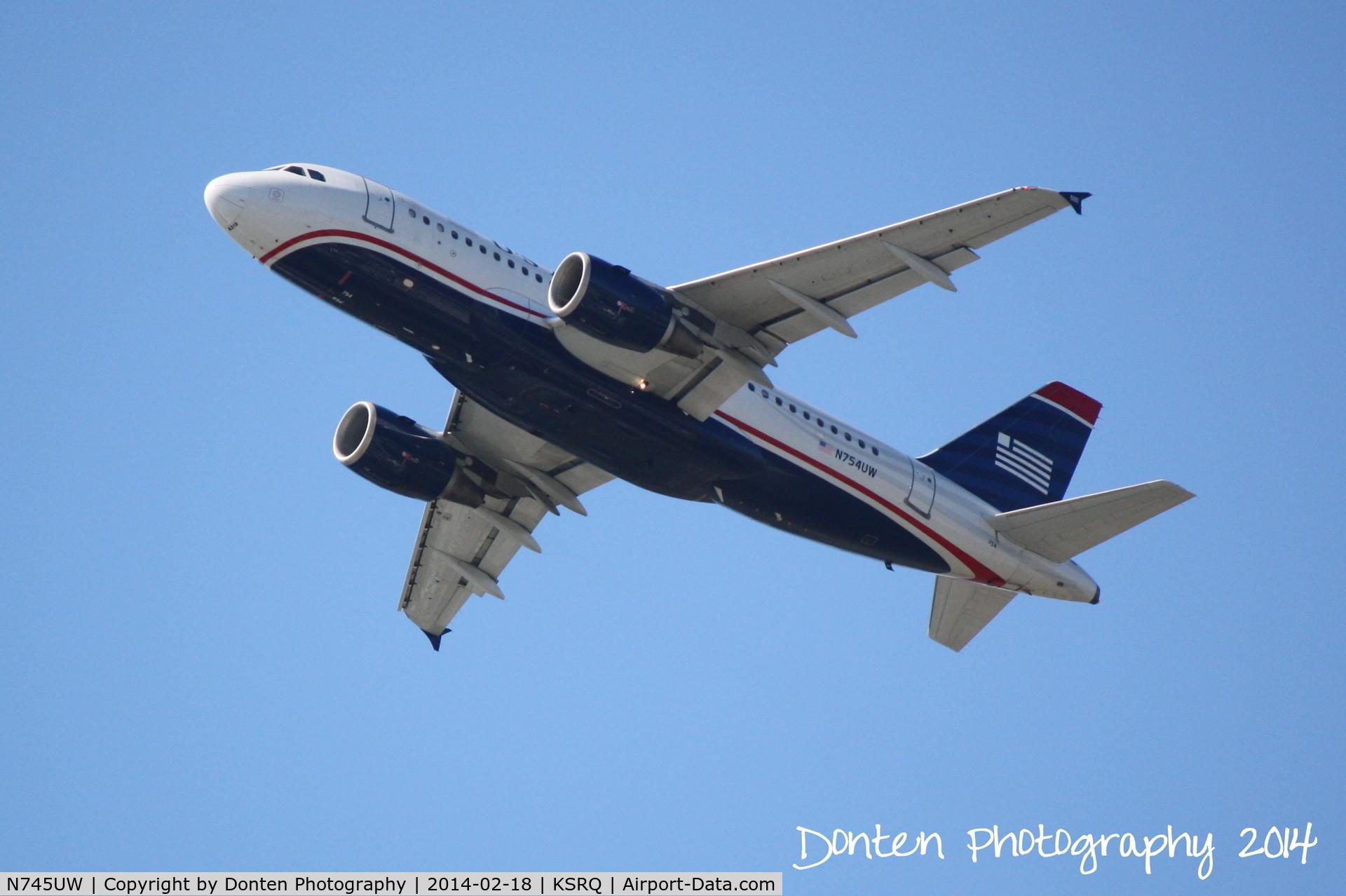N745UW, 2000 Airbus A319-112 C/N 1289, US Air Flight 1801 (N754UW) departs Sarasota-Bradenton International Airport enroute to Charlotte-Douglas International Airport