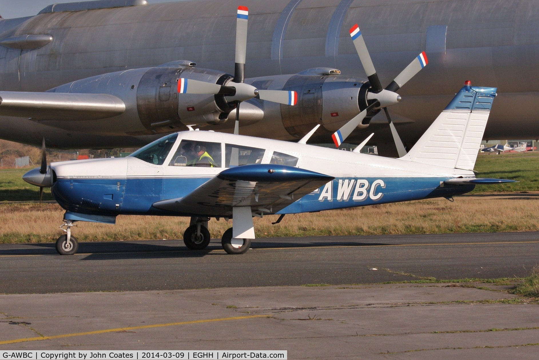 G-AWBC, 1968 Piper PA-28R-180 Cherokee Arrow C/N 28R-30572, Taxiing past the CL44