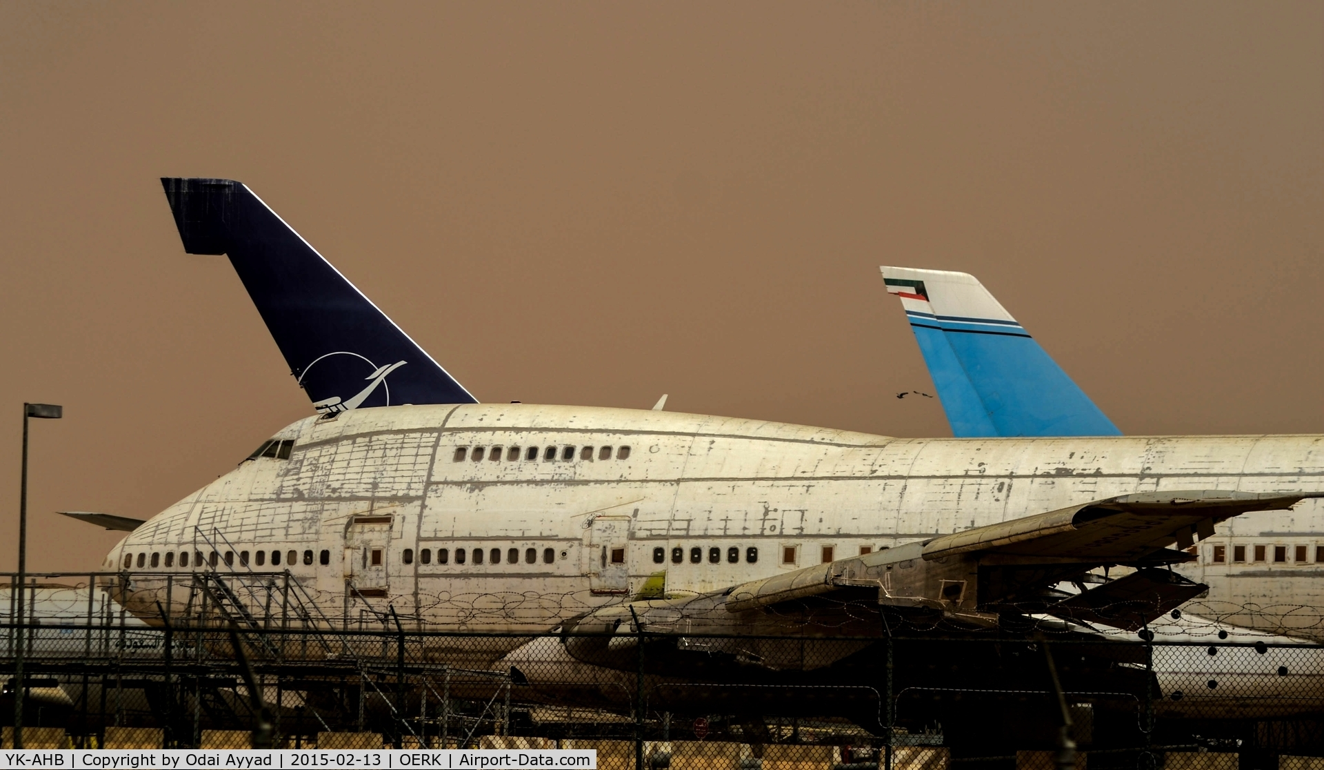 YK-AHB, 1976 Boeing 747SP-94 C/N 21175, Dusty day in Riyadh Airport and looking sadly to these two B747SP Syrian Airlines which are out of service