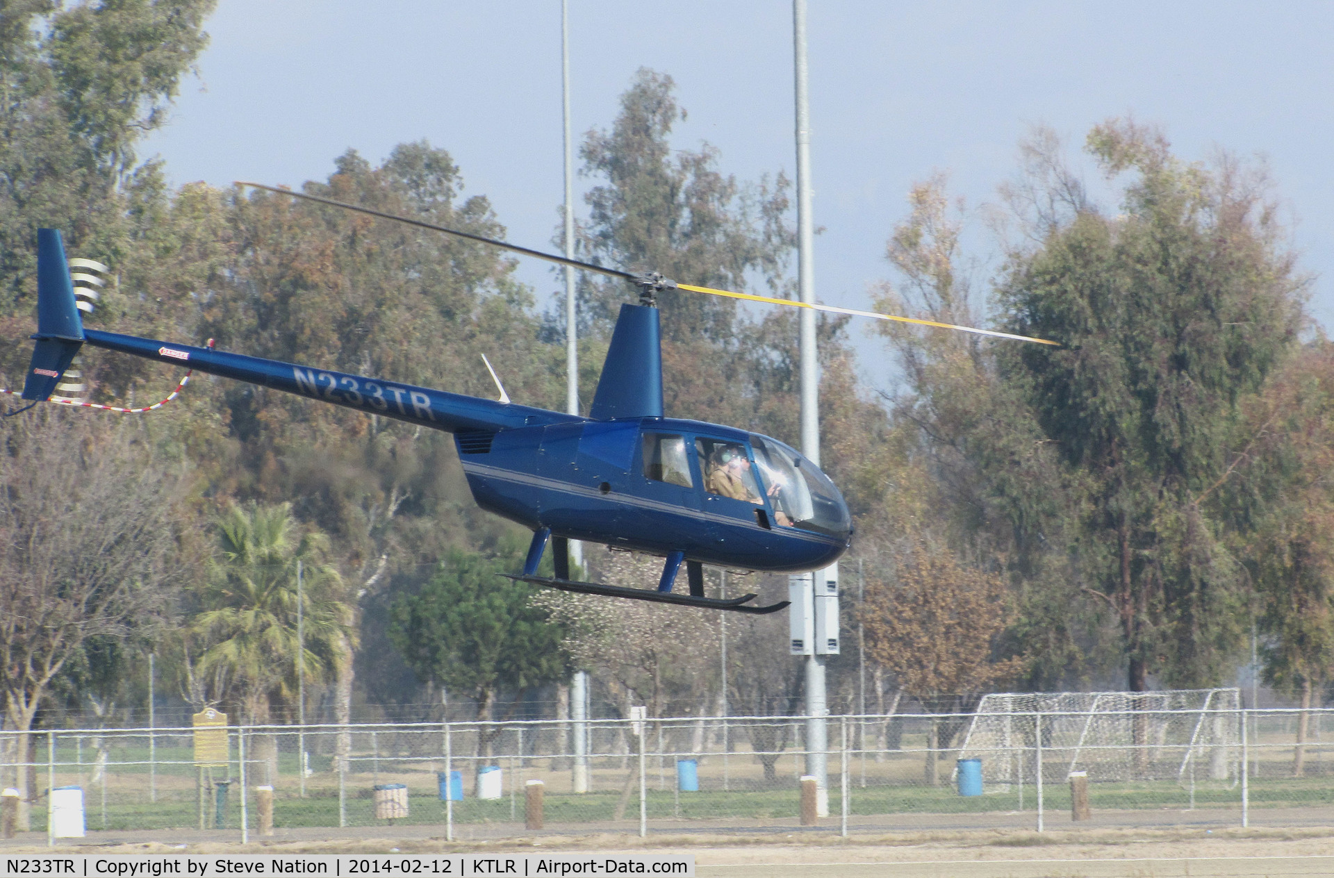 N233TR, 2003 Robinson R44 Raven II C/N 10062, Sierra Flite Robinson R44 II @ Mefford Field (Tulare, CA) for helicopter rides over the 2014 International Ag Expo