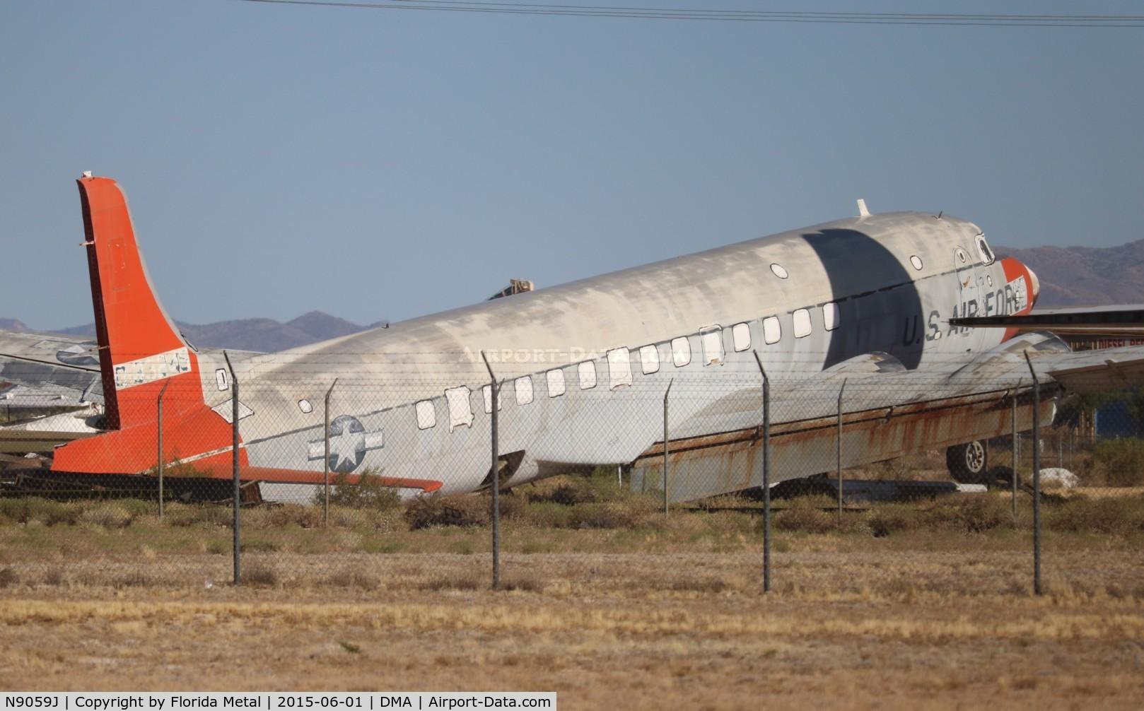 N9059J, Douglas EC-118A Liftmaster (DC-6A) C/N 44616, C-118A in a private scrapyard near Davis Monthan