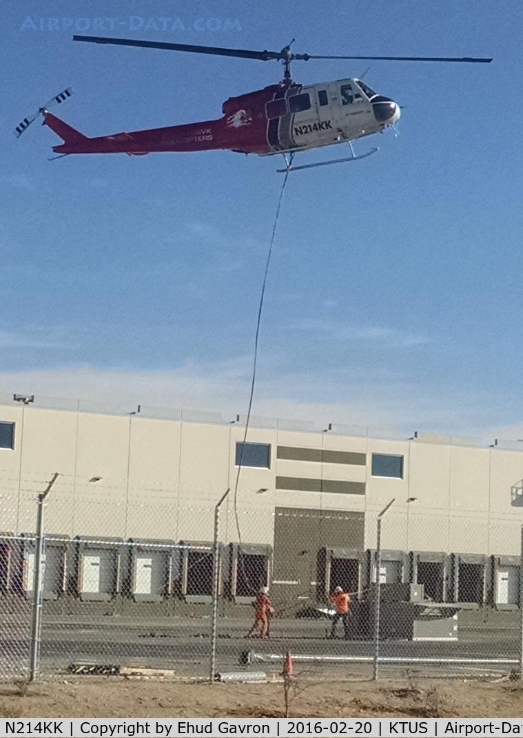 N214KK, 1964 Bell UH-1H Iroquois C/N 4267 (64-13560), N214KK long-line lifting HVAC units atop new distribution center in Tucson AZ.  One mile NE of KTUS.