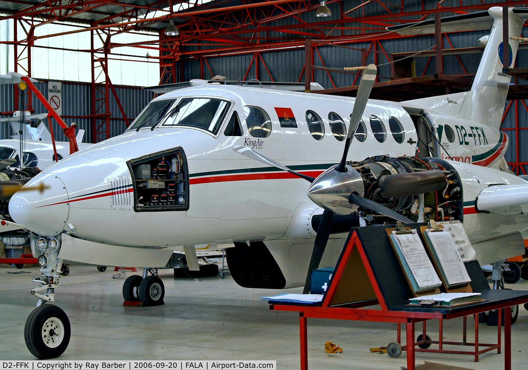 D2-FFK, 1981 Beech B200 King Air C/N BB-1026, Beech B200 Super King Air [BB-1026] (Tropicana) Lanseria~ZS 20/09/2006. Undergoing a overhaul in this tightly packed hangar.