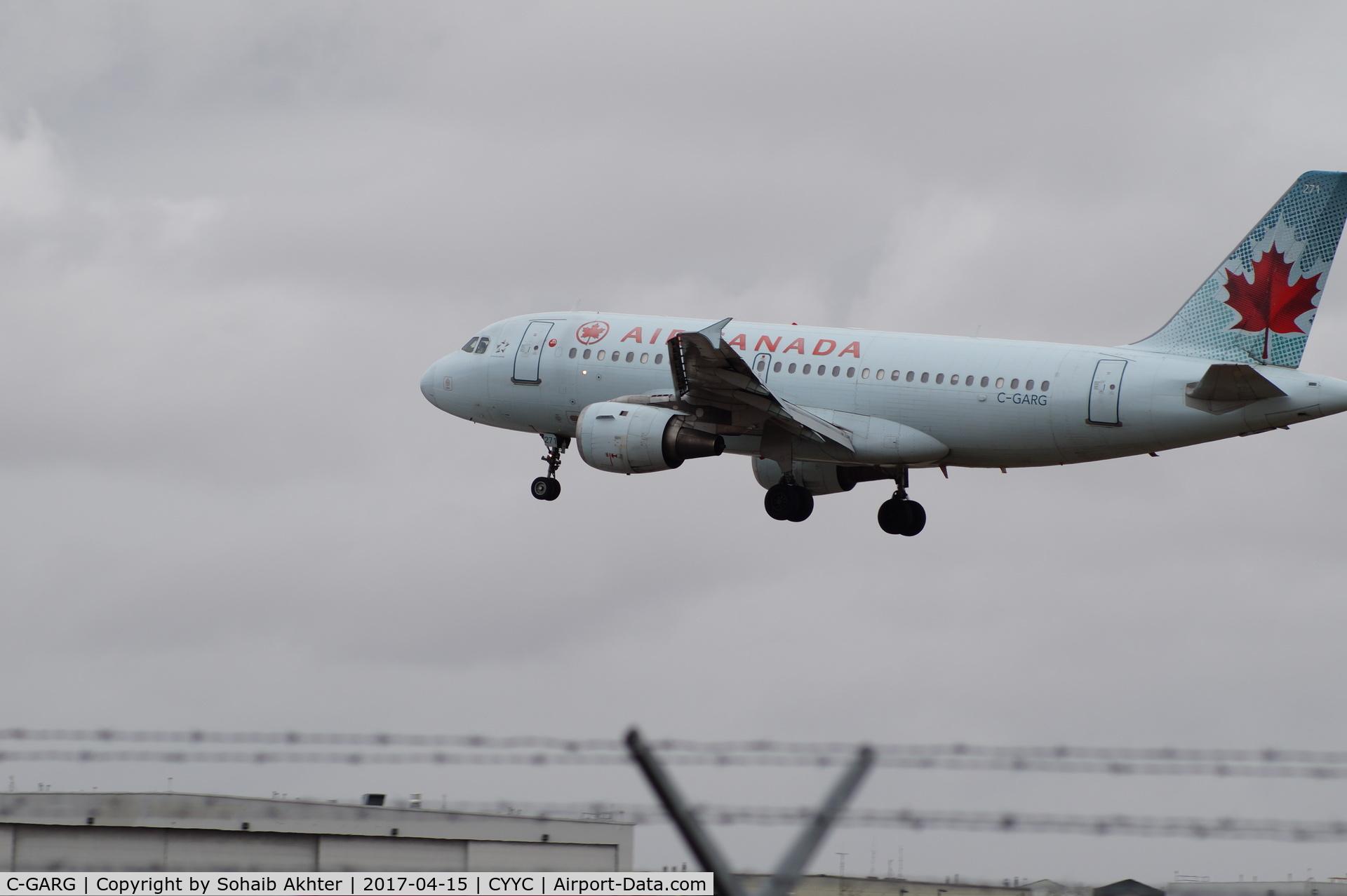 C-GARG, 1997 Airbus A319-114 C/N 742, A319 short final on RWY 35L YYC