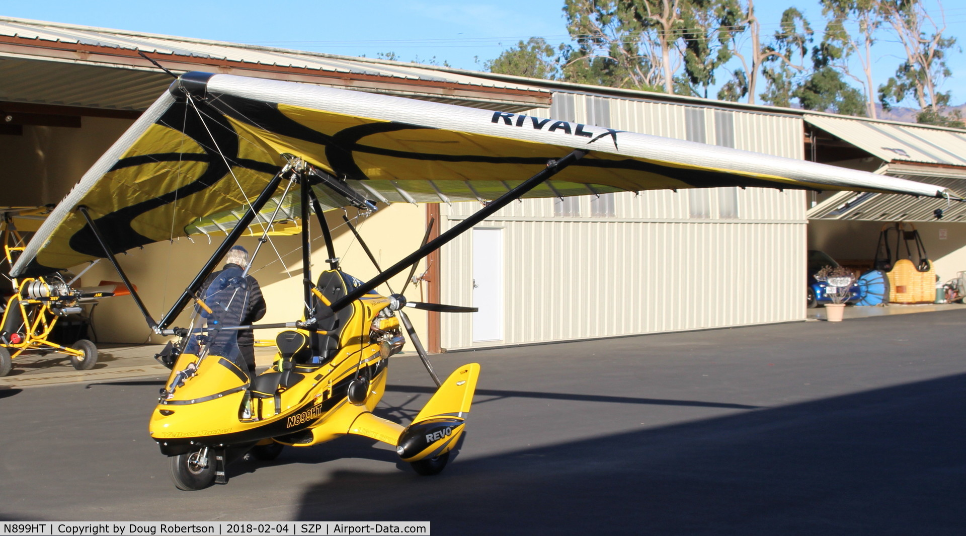 N899HT, 2016 Evolution Trikes Revo C/N 000618, 2016 Evolution Aircraft Inc. REVO weight-shift control LSA, Rotax 912ULS 100 Hp pusher, outside its hangar