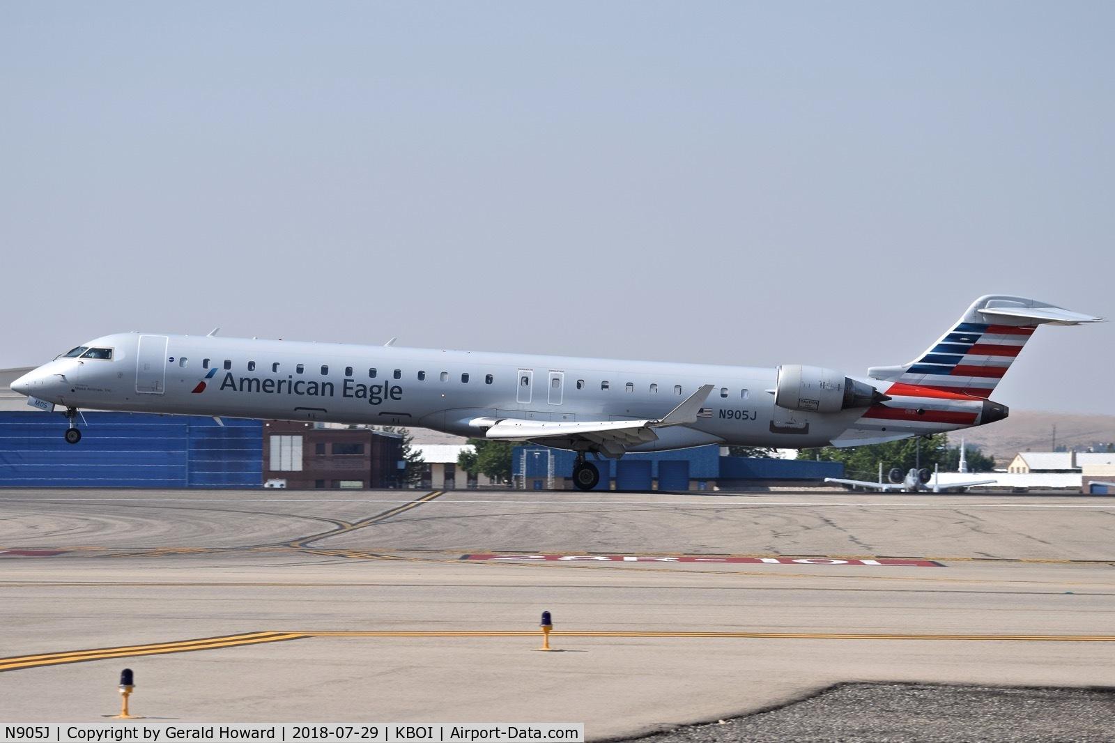 N905J, 2003 Bombardier CRJ-900 (CL-600-2D24) C/N 15005, Landing RWY 10L.