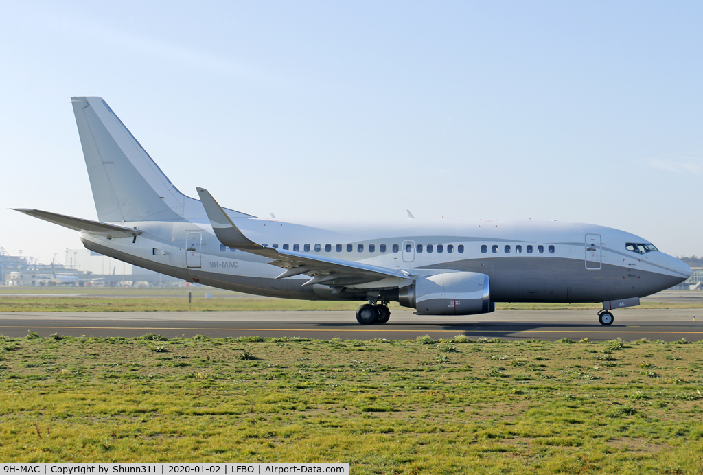 9H-MAC, 1990 Boeing 737-548 C/N 24968, Taxiing holding point rwy 14L for departure...