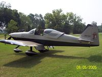 N97GC @ 2GC - Black & Gold RV6-A with cartoon character 'Opus' on tail - by Frank Goggio
