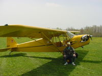 N22EF @ N41 - J3 on grass field - by Brian Peck
