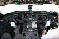N964CA @ CVG - The flight deck of N964CA (I sit on the left.) - by Lee Mills