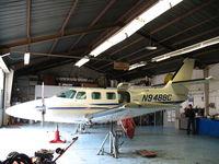 N9488C @ 0O5 - Cessna T303 on jacks at Davis Air Repair shop @ University Airport, Davis, CA - by Steve Nation